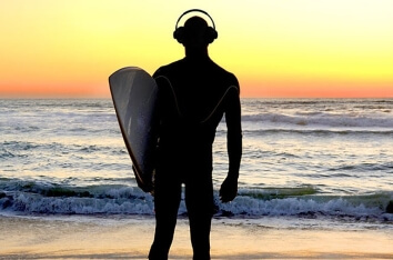Surfer Listening to Music